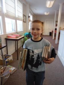 a boy, reading books!