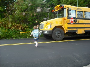 Child and schoolbus